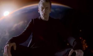 The Twelfth Doctor sat on top of the TARDIS