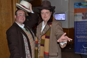 Fans in costumes; Seventh and Fourth Doctors