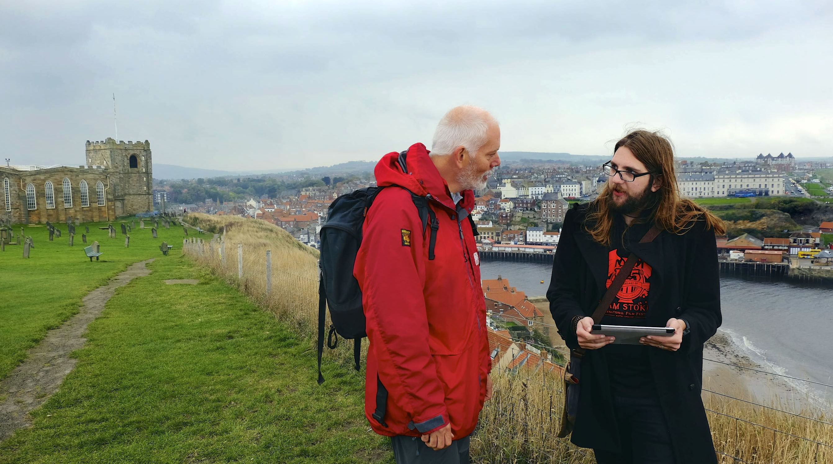 Bernie McLinden and Michael McCarthy try out the new Bram Stoker App on the clifftop above Whitby. ©Tony Bartholomew / Turnstone Media