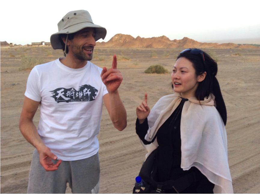 Jenny Wu & Adrien Brody singing in the Gobi Desert, China, 2014.